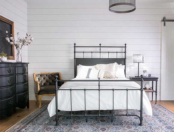 country/rustic bedroom with Magnolia Home trellis bed