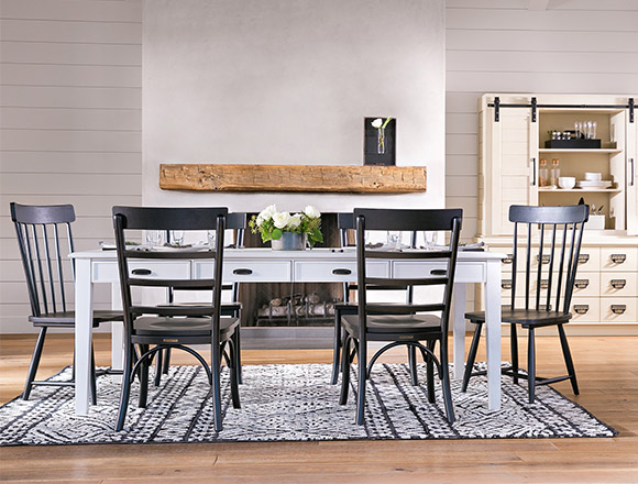 country/rustic dining room with Magnolia Home Keeping dining table